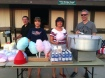 Chamber President Blake Waters, Secretary Gayle Runnels, former Vice-President Mary Fallesen and her husband, Jon, make popcorn and cotton candy for the Basehor 4th of July Celebration.