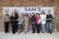 Basehor Chamber members celebrate the Grand Opening and ribbon cutting with Sam's Liquor on Friday, February 13, 2015.